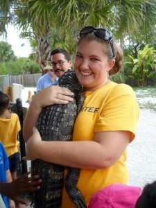Student holding Alligator