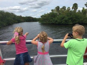 Kids look for marine life aboard the MV Edison Explorer on the Caloosahatche River