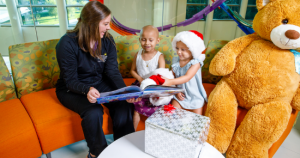 Nurse reading to children at Golisano Children's Hospital